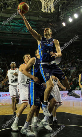 Argentina's Emanuel Ginobili, top, goes up for a shot during a FIBA Americas Championship basketball game Canada in Mar del Plata, Argentina, . The top two finishers of the tournament get an automatic berth in the 2012 London Olympics and the next three advance to the last-chance Olympic qualifier to be held in July 2012