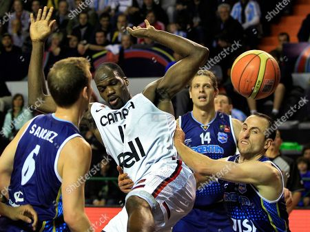 Canada's Joel Anthony, center, is grabbed by Argentina's Emanuel Ginobili, right, as Argentina's Juan Sanchez, left, looks on during a FIBA Americas Championship basketball game in Mar del Plata, Argentina, . The top two finishers of the tournament get an automatic berth in the 2012 London Olympics and the next three advance to the last-chance Olympic qualifier to be held in July 2012