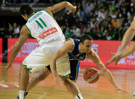 Argentina's Emanuel Ginobili, right, falls down after attempting to dribbles past Brazil's Rafael Hettsheimer during a FIBA Americas Championship basketball game against Brazil in Mar del Plata, Argentina, . The top two finishers of the tournament get an automatic berth in the 2012 London Olympics and the next three advance to the last-chance Olympic qualifier to be held in July 2012