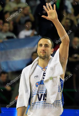 Argentina's Emanuel 'Manu' Ginobili waves to fans after his team's 84-58 victory over the Dominican Republic during a FIBA Americas Championship basketball game in Mar del Plata, Argentina, . The top two finishers of the tournament get an automatic berth in the 2012 London Olympics and the next three advance to the last-chance Olympic qualifier to be held in July 2012
