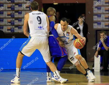 Argentina's Emanuel 'Manu' Ginobili, right, attempts to dribble past Dominican Republic's Luis Flores, center, and Argentina's Juan Gutierrez during a FIBA Americas Championship basketball game in Mar del Plata, Argentina, . The top two finishers of the tournament get an automatic berth in the 2012 London Olympics and the next three advance to the last-chance Olympic qualifier to be held in July 2012