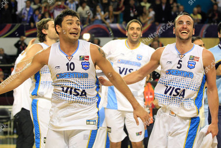 Argentina's Carlos Delfino, left, and teammate Emanuel 'Manu' Ginobili celebrate after defeating Puerto Rico 81-79 in their FIBA Americas Championship semi-final basketball game in Mar del Plata, Argentina, . Argentina will square off with Brazil in Sunday's final. As the top two finishers of the tournament, both teams get an automatic berth in the 2012 London Olympics. Brazil defeated the Dominican Republic 83-76