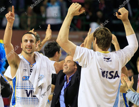 Argentina's Emanuel 'Manu' Ginobili, left, and teammate Andres Nocioni, right, celebrate their 81-79 over Puerto Rico in a FIBA Americas Championship semi-final basketball game in Mar del Plata, Argentina, . Argentina will square off with Brazil in Sunday's final. As the top two finishers of the tournament, both teams get an automatic berth in the 2012 London Olympics. Brazil defeated the Dominican Republic 83-76
