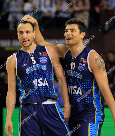 Stock Picture of Argentina's Emanuel 'Manu' Ginobili, left, and Carlos Delfino celebrate their 80-75 victory over Brazil in their FIBA Americas Championship final basketball game in Mar del Plata, Argentina