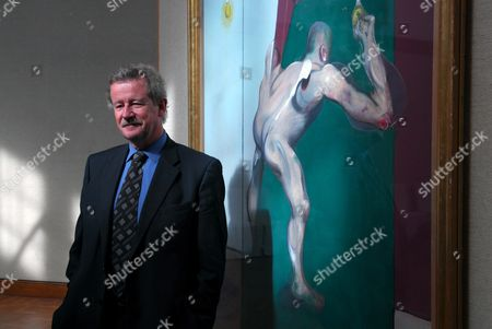 Sir Christopher Frayling, Rector and Vice-Provost of the Royal College Of Art stands next to a Francis Bacon painting titled 'Study From The Human Body, man Turning on the Light' (1969). The painting is being offered by the Royal College of Art who were given the painting directly by the artist as rent for the use of a studio in Cromwell Road in 1969. The painting is being auctioned by Christies and is expected to realise £7 to £9 million GBP.