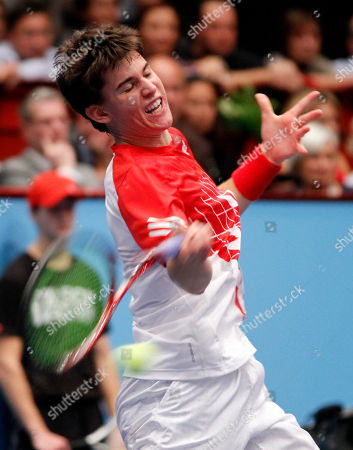 Dominic Thiem Dominic Thiem of Austria returns the ball to Thomas Muster of Austria during their match at the Erste Bank Open tennis trophy in Vienna, Austria, on