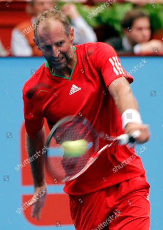 Thomas Muster Thomas Muster of Austria returns the ball to Dominic Thiem of Austria during their match at the Erste Bank Open tennis trophy in Vienna, Austria, on