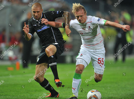 Patrick Wolf, Renat Yanbaev Graz's Patrick Wolf, left, challenges for the ball with Lokomotiv Moscow's Renat Yanbaev during the Group L Europa League soccer match between SK Sturm Graz and FC Lokomotiv Moscow in Graz