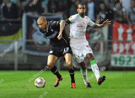Patrick Wolf, Maicon Graz's Patrick Wolf, left, challenges for the ball with Lokomotiv Moscow's Maicon during the Group L Europa League soccer match between SK Sturm Graz and FC Lokomotiv Moscow in Graz