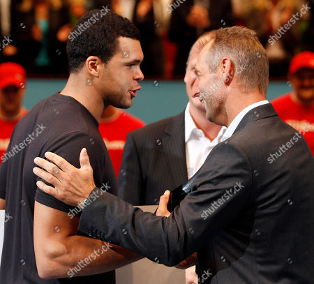 Jo-Wilfried Tsonga, Thomas Muster Winner Jo-Wilfried Tsonga of France talks with Austria's Thomas Muster, from left, after the final match at the Erste Bank Open tennis tournament in Vienna, Austria, . Tsonga won the final match against Juan martin Del Potro with 6-7, 6-3 and 6-4