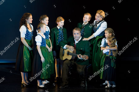 "Wietske van Tongeren, Uwe Kroeger Wietske van Tongeren, third right, in the role of Maria Rainer and Uwe Kroeger, center, as Captain Georg von Trapp perform during a dress rehearsal for the musical ""The Sound of Music"" by Richard Rogers in Salzburg, . Premiere is on Sunday, Oct. 23, 2011"