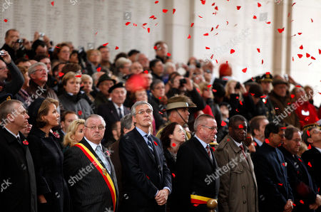 Yves Leterme, Princess Mathilde Belgium's Prime Minister Yves Leterme, front left, and Belgium's Princess Mathilde, front second left, watch red poppies fall from the ceiling during an Armistice Day ceremony at the Menin Gate in Ypres, Belgium on . British and Commonwealth soldiers often passed through the 'Menenpoort' on their way to the front lines, some 300,000 of them being killed in the Ypres Salient. Approximately ninety thousand of these soldiers have no known graves and their names are now inscribed on walls of the gate