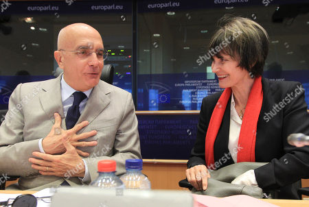 Micheline Calmy-Rey, Gabriele Albertini Chairman of the European Foreign Affairs Committee Gabriele Albertini, left, talks with Switzerland's President Micheline Calmy-Rey, prior to address the European Foreign Affairs Committee at the European Parliament in Brussels