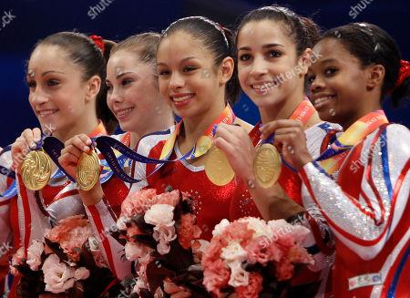 USA's gymnasts, from left, Jordyn Wieber, McKayla Maroney, Sabrina Vega, Alexandra Raisman and Gabrielle Douglas, celebrate on the podium winning the women's team final at the Artistic Gymnastics World Championships in Tokyo, Japan