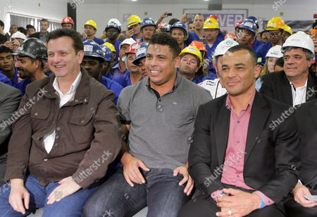 Ronaldo, Cafu, Gilberto Kassab Former Brazil's soccer players Ronaldo, center, Cafu, right, and Sao Paulo's Mayor Gilberto Kassab, left, follow on a TV screen a FIFA ceremony during which the city of Sao Paulo was confirmed as the host of the opening ceremony for the 2014 Soccer World Cup in Sao Paulo, Brazil