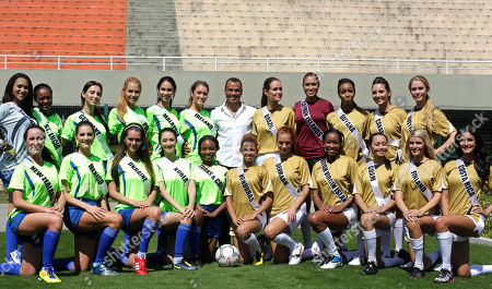 Former Brazilian soccer player Cafu, center, poses for pictures with Miss Universe contestants after a soccer match in Sao Paulo, Brazil, . Back row, from left: Tanzania's Nelly Kamwelu, St Lucia's Joy-Ann Biscette, Germany's Valeria Bystritskaia, Poland's Rozalia Mancewicz, Malaysia's Debora Henry, Ireland's Aoife Hannon, Brazil's Priscila Machado, Cayman Island's Cristin Alexander, Guyana's Kara Lord, Canada's Chelsae Durocher, Scherri-lee Biggs; Front row from left: New Zealand's Priyani Puketapu, Mexico's Karin Ontiveros, Ukraine's Olesia Stefanko, Korea's Sora Chong, Turks & Caicos' Easher Parker, Honduras' Keilyn Gomez, Denmark's Sandra Amer, British Virgin Islands' Sheroma Hodge, Guam's Shayna Jo Afaisen, Finland's Pia Pakarinen, and Costa Rica's Johanna Solano. The Miss Universe pageant will be held in Sao Paulo on Sept. 12