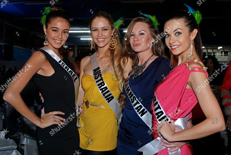 Miss Universe contestants, from left, Kim Edry, of Israel, Australia's Scherri-lee Biggs, Kazakhstan's Valeriya Aleinikova, and Great Britain's Chloe-Beth Morgan pose for pictures as they visit a samba school in Sao Paulo, Brazil, . The Miss Universe pageant will be held in Sao Paulo on Sept. 12