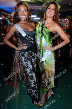 Miss Universe contestants Anastagia Pierre, of Bahamas, left, and Colombia's Catalina Robayo pose for a picture as they visit a samba school in Sao Paulo, Brazil, . The Miss Universe pageant will be held in Sao Paulo on Sept. 12