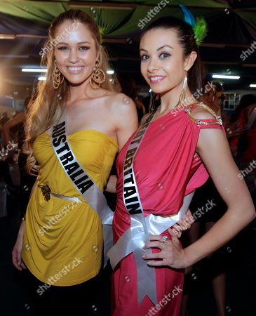 Miss Universe contestants Scherri-lee Biggs, of Australia, and Great Britain's Chloe-Beth Morgan pose for pictures as they visit a samba school in Sao Paulo, Brazil, . The Miss Universe pageant will be held in Sao Paulo on Sept. 12