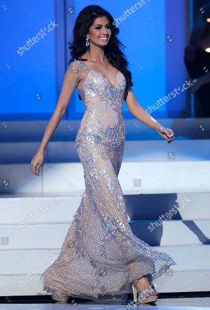 Miss Philippines Shamcey Supsup wears an evening gown as she competes at the Miss Universe pageant in Sao Paulo, Brazil