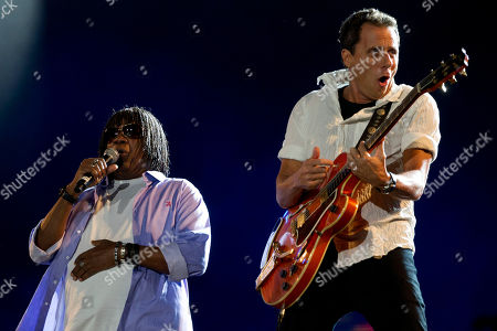 Brazilian musicians Milton Nascimento, left, and Tony Bellotto, perform at the Rock in Rio music festival in Rio de Janeiro, Brazil, . The festival, which runs through Oct. 2, will include performances by Katy Perry, Rihanna, Stevie Wonder, Red Hot Chili Peppers, Metallica, Guns N' Roses and Coldplay