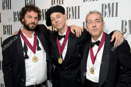 Stock Image of Migi Drummond, Ben Volpeliere-Pierrot, Julian Brookhouse From left, Migi Drummond, Ben Volpeliere-Pierrot, Julian Brookhouse, from Curiosity Killed the Cat, arrive for the BMI Awards at a central London venue