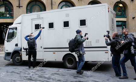 Photographers take pictures of a prison van as it leaves Southwark Crown Court in London, . Cricket agent Mazhar Majeed and Pakistan cricketers Salman Butt, Mohammad Asif and Mohammad Amir were all given prison terms after being convicted at Southwark Crown Court of fixing parts of a cricket Test match against England in August 2010