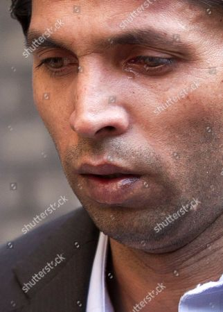 Former Pakistan cricket bowler Mohammed Asif appears to have a tear coming from his eye as he arrives late for his case at Southwark Crown Court in London, . Salman Butt, Mohammed Asif and Pakistan teammate Mohammed Amir are accused of conspiring with player agent Mazhar Majeed to bowl deliberate no-balls in the fourth cricket test match against England at Lord's in August of last year. Butt and Asif deny the charges. Majeed and Amir are not required to appear in court