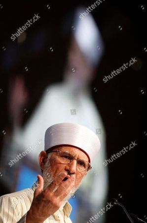 Islamic scholar Dr. Muhammad Tahir-ul-Qadri addresses the audience during an Islamic peace conference in London, . The conference attended by thousands of British and European Muslims is aimed at tackling extremists and promoting peace, tolerance and community cohesion in wake of recent riots and 9/11 anniversary