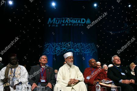 Islamic scholar Dr. Muhammad Tahir-ul-Qadri, center, is seated with representatives from various religions during an Islamic peace conference in London, . The conference attended by thousands of British and European Muslims is aimed at tackling extremists and promoting peace, tolerance and community cohesion in wake of recent riots and 9/11 anniversary