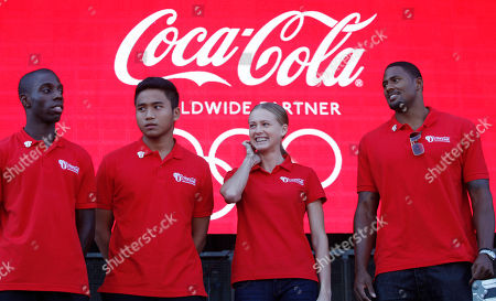Darius Knight, Dayyan Jaffar, Kseniya Vdovina, David Oliver Olympic hopefuls from left, Darius Knight, 21, a British table tennis player, Dayyan Jaffar, 17, an archer from Singapore, Kseniya Vdovina, 24, a 400 metre sprinter from Russia, and David Oliver, 29 a 110 metre hurdler from the United States pose for the photographers during the launch of a global campaign by London 2012 Olympic Games' major sponsor Coca Cola, in East London