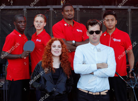 Mark Ronson, Katy B, Darius Knight, Kseniya Vdovina, David Oliver, Dayyan Jaffar British music producer Mark Ronson, front right, and singer-songwriter Katy B, front left, back dropped by Olympic hopefuls posing for the photographers during the launch of a global campaign by London 2012 Olympic Games' major soft drinks sponsor, in East London, . The athletes are from left to right, Darius Knight, 21, a British table tennis player, Kseniya Vdovina, 24, a 400 meter Russian sprinter, David Oliver, 29 a 110 meter U.S. hurdler and Dayyan Jaffar, 17, an archer from Singapore