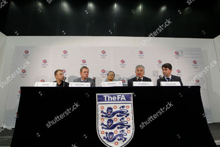 Stuart Pearce, Hope Powell, David Bernstein, Andy Hunt, Adrian Bevington English FA Chairman David Bernstein, second right, talks to the media during a press conference at Wembley Stadium in London to announce the appointment of Team GB men's soccer head coaches Stuart Pearce, second left, and women's soccer head coach Hope Powell, center, . Listens on are Team GB Chef de Mission Andy Hunt, left, and Club England Managing Director Adrian Bevington