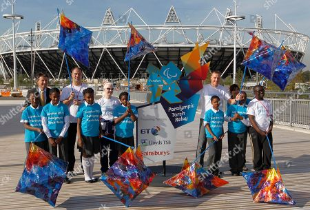 Stock Image of Sebastian Coe, David Roberts, Aileen McGlynn, Danny Crates Chair of London Olympic Organising Committee, Sebastian Coe, rear left, poses for the media with school children with their themed lanterns and Paralympic athletes during the announcement of plans for the lighting of the Paralympic flame and vision of the Paralympic torch relay at the Olympic Park in London, . Paralympic athletes in the back row are swimmer David Roberts, second left, tandem cyclist Aileen McGlynn, third left, and former Paralympic 800m Champion Danny Crates, second right