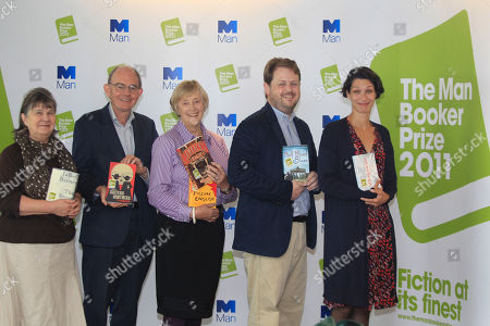 The judges of the 2011 Man Booker Prize for fiction, from left to right, author, Susan Hill, author and politician, Chris Mullin, author and former Director-General of the MI5, Dame Stella Rimington, writer and journalist, Matthew d'Ancona, and Head of Books at the Daily Telegraph newspaper, Gaby Wood,pose for the photographers following a news conference announcing the 2011 Man Booker Prize shortlisted novels, in London, Tuesday, Sept, 6, 2011. The winner of the prestigious literary award who will receive 50,000 British pounds, will be announced on