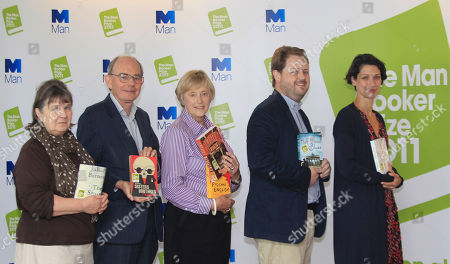 The judges of the 2011 Man Booker Prize for fiction, from left to right, author, Susan Hill, author and politician, Chris Mullin, author and former Director-General of the MI5, Dame Stella Rimington, writer and journalist, Matthew d'Ancona, and Head of Books at the Daily Telegraph newspaper, Gaby Wood, pose for the photographers following a news conference announcing the 2011 Man Booker Prize shortlisted novels, in London, Tuesday, Sept, 6, 2011. The winner of the prestigious literary award who will receive 50,000 British pounds, will be announced on