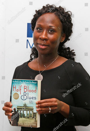 Esi Edugyan Man Booker prize shortlisted author Esi Edugyan poses for the photographers holding a copy of her book during a media event in a central London hotel, . The winner of the prestigious literary award, who will receive 50,000 British pounds ($78,770), will be announced on Tuesday, Oct. 18, 2011