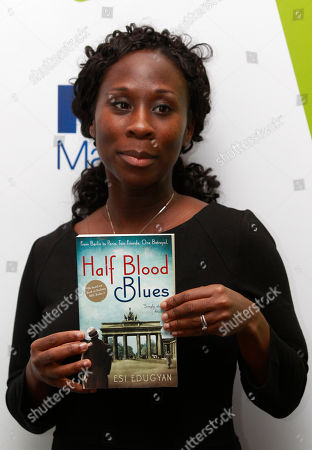 Esi Edugyan Man Booker prize shortlisted author Esi Edugyan poses for photographers holding a copy of her book during a media event in a central London hotel, . The winner of the prestigious literary award, who will receive 50,000 British pounds ($78,770), will be announced on Tuesday, Oct. 18, 2011