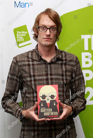 Stock Picture of Patrick deWitt Man Booker prize shortlisted author Patrick deWitt poses for photographers holding a copy of his book during a media event in a central London hotel, . The winner of the prestigious literary award, who will receive 50,000 British pounds ($78,770), will be announced on Tuesday, Oct. 18, 2011