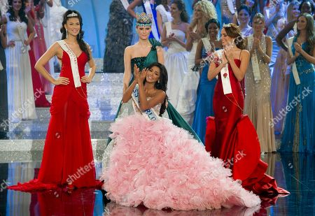 Ivian Sarcos, Amanda Perez, Gwendoline Ruais, Alexandria Mills Miss Venezuela, Ivian Sarcos, center seated, surrounded by Miss Philippines, Gwendoline Ruais, left, Miss Puerto Rico, Amanda Perez, right, reacts after being crowned Miss World 2011 by former Miss World Alexandria Mills, centre standing, at a central London venue