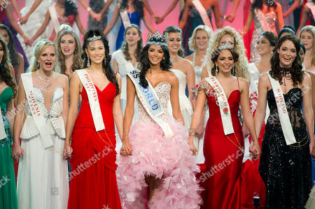 Ivian Sarcos, Amanda Perez, Gwendoline Ruais Miss Venezuela, Ivian Sarcos, center, surrounded by Miss Philippines, Gwendoline Ruais, left and Miss Puerto Rico, Amanda Perez, right, reacts after being crowned Miss World 2011 at a central London venue