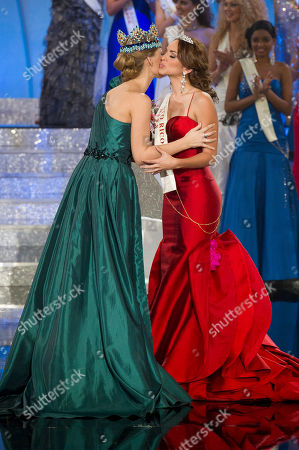 Miss Puerto Rico, Amanda Perez, Alexandria Mills Miss Puerto Rico, Amanda Perez, right, reacts after placing third in the Miss World 2011 contest by former Miss World Alexandria Mills, left, at a central London venue