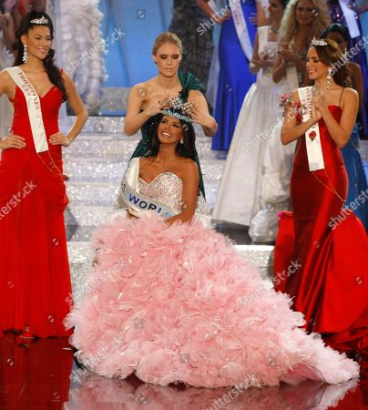 Ivian Sarcos Miss Venezuela Ivian Sarcos, center, is crowned winner as Miss Philippines Gwendoline Ruais, left, who was second, and Miss Puerto Rico Amanda Perez, right, who was third, applaud at the Miss World competition at Earls Court in London