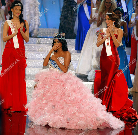 Ivian Sarcos Miss Venezuela Ivian Sarcos, center, reacts as Miss Philippines Gwendoline Ruais, left, and Miss Puerto Rico Amanda Perez, right, applaud after she is crowned winner of the Miss World competition at Earls Court in London