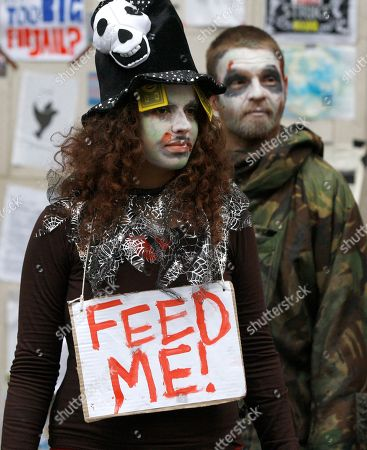 Stock Image of Protestors dressed as zombies are seen outside St Paul's Cathedral in London, . The Dean of the cathedral, The Very Reverend Graeme Knowles resigned Monday amid criticism of the handling of the Occupy London protests