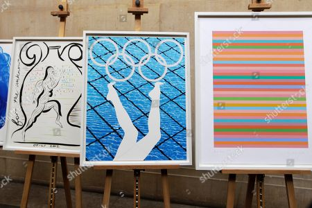 Olympic posters 'For the Unknown Runner' by Chris Ofili, left, 'Divers' by Anthea Hamilton, center, and 'Rose Rose' by Bridget Riley are seen during an unveiling ceremony of London 2012 Olympic and Paralympic posters at the Tate Britain art gallery in London