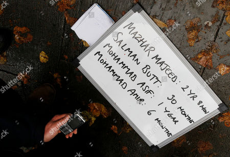 A media whiteboard showing the prison terms given to cricket agent Mazhar Majeed and former Pakistan cricketers Salman Butt, Mohammad Asif and Mohammad Amir is seen outside Southwark Crown Court in London, . Pakistan cricketers Salman Butt, Mohammad Asif and Mohammad Amir were all convicted of fixing parts of a cricket Test match against England in August 2010