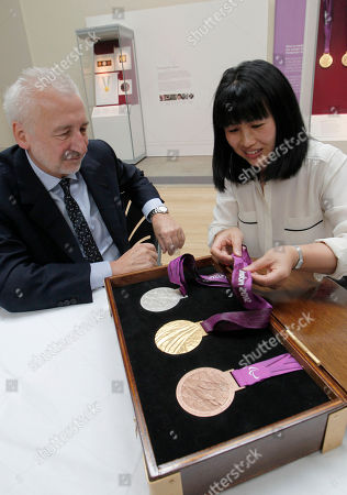 Lin Cheung, Sir John Sorrell Lin Cheung, jewellery artist and the medals' designer, right, shows the medals to Sir John Sorrell, Chair of London 2012 medals selection panel, during the unveiling of the London 2012 Paralympic medals at the British Museum in London