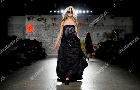A model wears an outfit by Danish designer Peter Jensen at the Victoria and Albert Museum, London. Each of the models wore fashion pieces from a decade of Jensen's fashion collections which are based upon female muses, historic figures and film characters