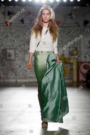 A model presents an outfit by Danish designer Peter Jensen at the Victoria and Albert Museum, London. Each of the models wore fashion pieces from a decade of Jensen's fashion collections which are based upon female muses, historic figures and film characters